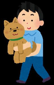 抱っこする犬